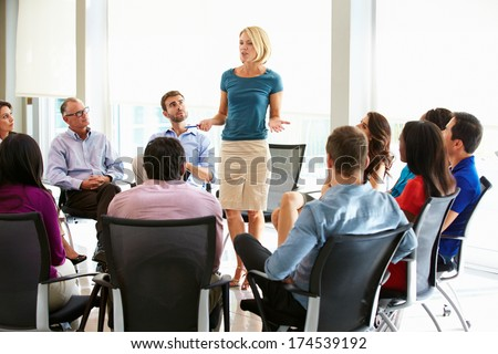 Businesswoman Addressing Multi-Cultural Office Staff Meeting - stock photo