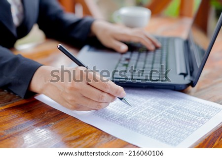 Businesswoman analyzing investment charts with laptop. Accounting - stock photo