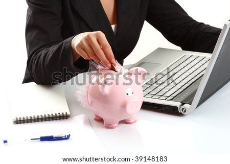 businesswoman and a  piggy bank - stock photo