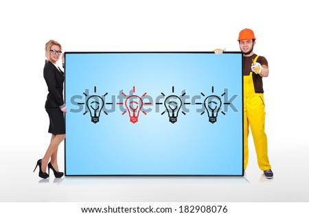 businesswoman and builder holding plasma panel with lamp - stock photo