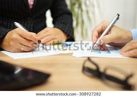businesswoman and businessman are discussing about financial data on meeting - stock photo