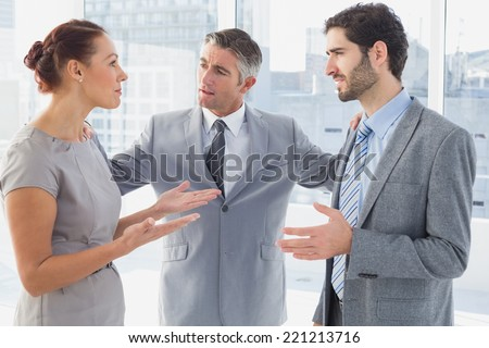 Businesswoman arguing with co-worker in office - stock photo