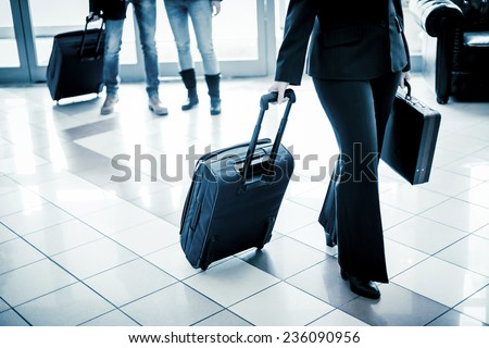 Businesswoman arriving at the hotel. - stock photo