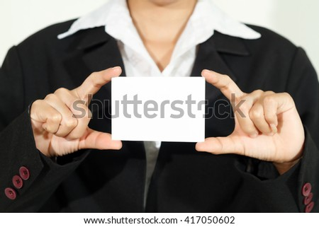 businesswoman asia holding and shown a business card on white background