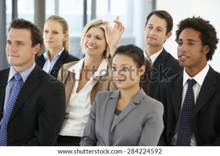 Businesswoman Asking Question During Presentation - stock photo