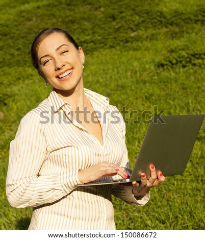 businesswoman at lunchtime with a computer - stock photo