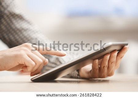 Businesswoman at office working with digital tablet - stock photo