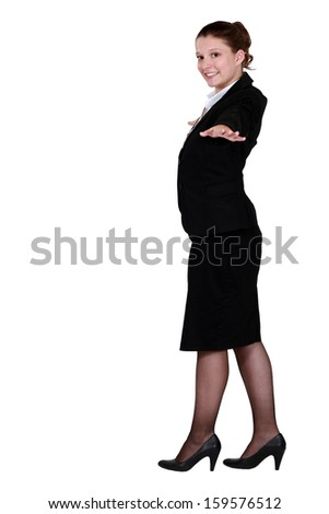Businesswoman balancing - stock photo