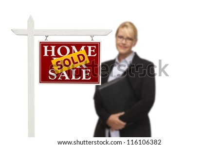 Businesswoman Behind Sold Home For Sale Real Estate Sign Isolated on a White Background. - stock photo