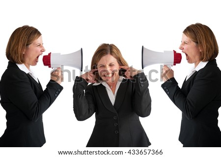 businesswoman being shouted at by businesswomen with megaphone - stock photo