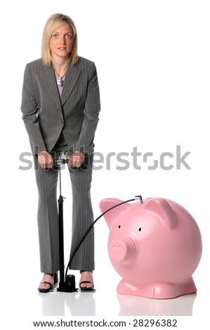 Businesswoman blowing up piggy bank isolated over white