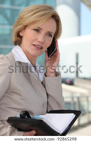 Businesswoman booking an appointment - stock photo