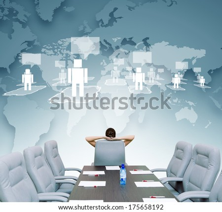 Businesswoman boss in conference room sitting with back in chair - stock photo