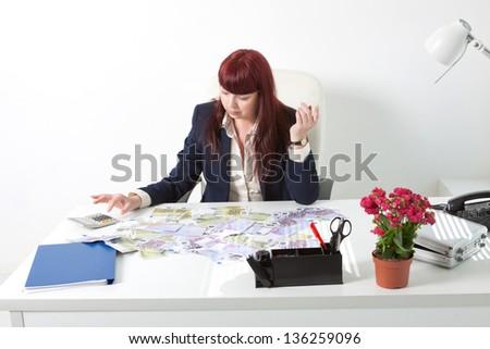 businesswoman calculate her money - stock photo