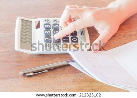 Businesswoman calculated account balance, stock photo - stock photo
