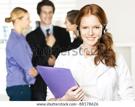 businesswoman call with headset  in office - stock photo