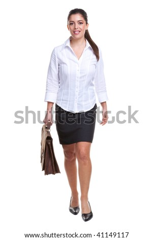 Businesswoman carrying a briefcase walking towards, isolated on a white background. - stock photo