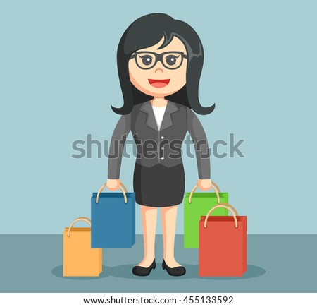 businesswoman carrying shopping bags