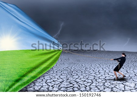 Businesswoman changing reality of drought to spring season - stock photo