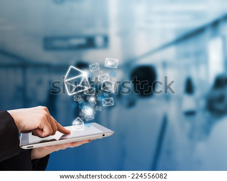 Businesswoman checking email in the subway station - stock photo