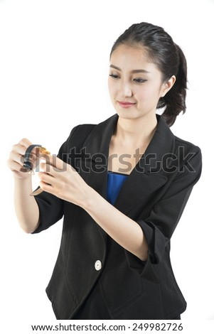 businesswoman checking her watch against a white background