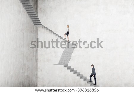 Businesswoman climbing steep stairs, businessman after her. Concrete background. Concept of career growth. - stock photo