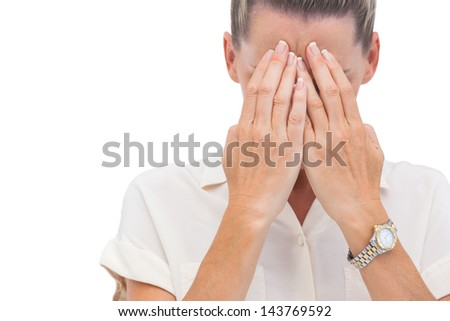 businesswoman covering her face on white background