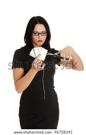 Businesswoman cutting credit cards with scissors - stock photo