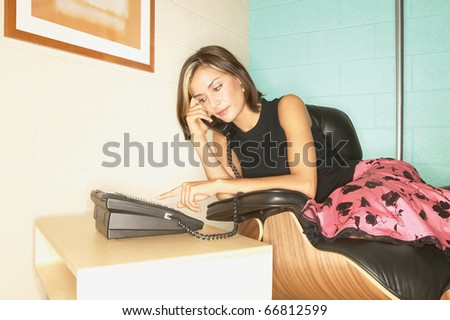Businesswoman dialing phone