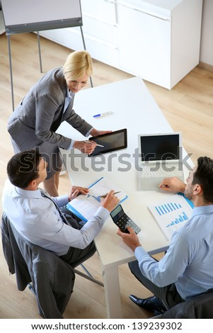 Businesswoman doing business presentation - stock photo