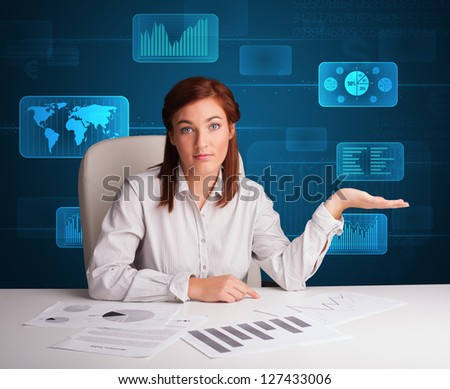 Businesswoman doing paperwork with futuristic digital backgroung