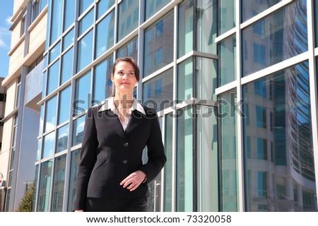 Businesswoman downtown - stock photo