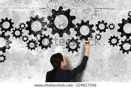 businesswoman draw gears concept - stock photo