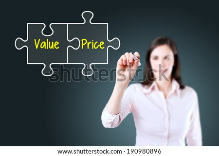 Businesswoman drawing a Value Price puzzle concept on the virtual screen. - stock photo