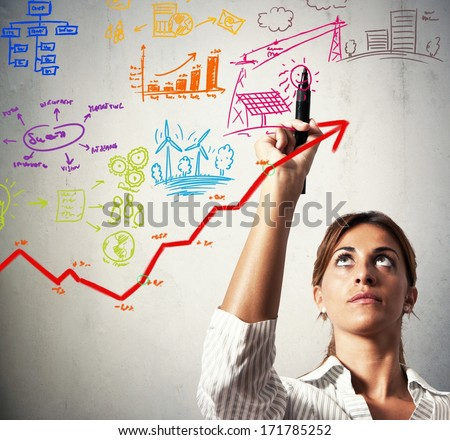 Businesswoman drawing business project with growing profit - stock photo
