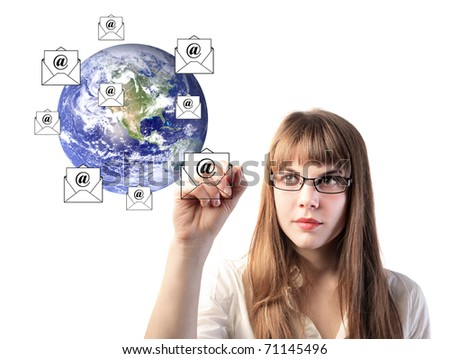 Businesswoman drawing e-mail symbols around the earth - stock photo