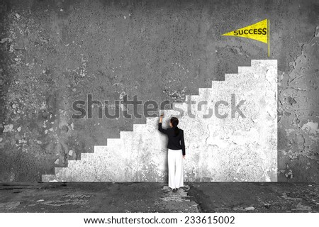 businesswoman drawing  ladder of success on the wall - stock photo