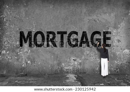 businesswoman drawing mortgage on the wall