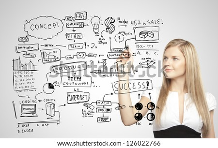 businesswoman drawing plan business strategy - stock photo