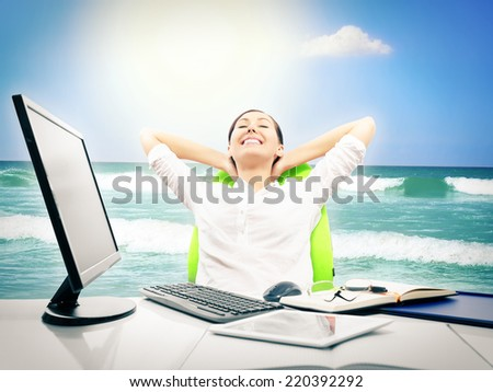 Businesswoman dreaming about vacation and relaxing at work - stock photo