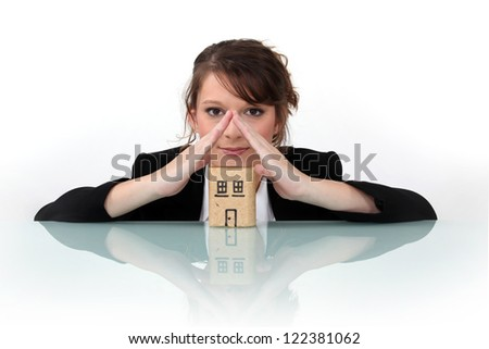 Businesswoman dreaming of a house