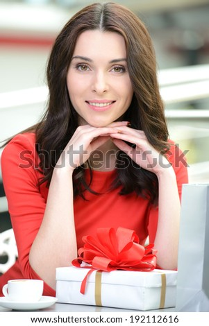 Businesswoman drinking coffee, tea in a coffee shop - stock photo