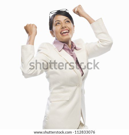 Businesswoman exclaiming with joy - stock photo
