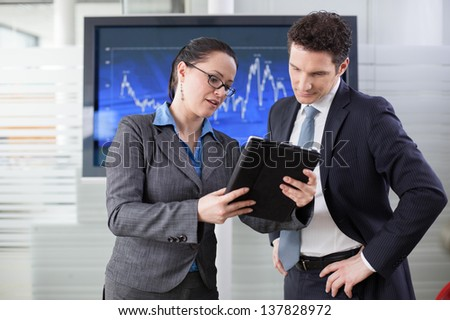 Businesswoman explaining future business plans to her colleague - stock photo