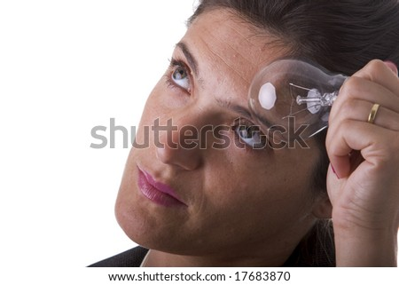 businesswoman face with a lamp over is head (idea concept) - stock photo