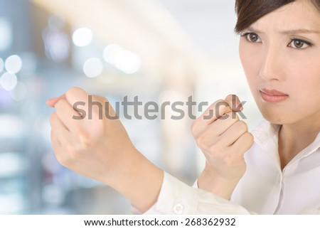 Businesswoman fight pose with confident expression on white background. - stock photo