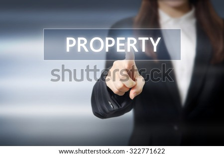 Businesswoman, Focus on hand pressing property button on virtual screens, business concept. - stock photo
