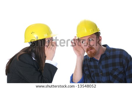 businesswoman gestures telling something to construction worker on workplace - stock photo