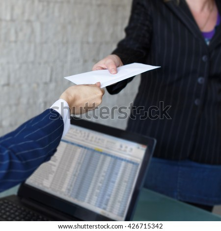 Businesswoman give envelope to partner in office, bribe, corruption - stock photo