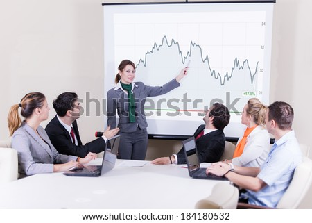 Businesswoman giving presentation at a meeting - stock photo